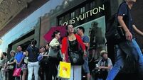 LVMH shares surge on Louis Vuitton sales in Asia