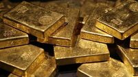 Gold rallies for a fourth straight day as oil prices tumble