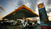 Shell's profits hit by further slide in oil prices