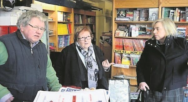 Gillian Powell with Eric and Breda Hickey in Bandon, Co Cork. The booksellers have been flooded eight times in 36 years. Picture: Denis Scannell