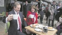 Enda Kenny and Joan Burton share a cuppa and a possible final farewell