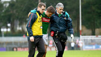 Lee Keegan is helped from the field by selector Tony McEntee and Dr. Sean Moffatt 31/1/2016