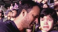 Little boy with autism overwhelmed with emotion at his favourite band Coldplay's concert