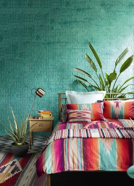 Bold prints work best when contrasted with a solid block of colour. A green wall does the trick here, but the inclusion of a plain cushion or border on textiles would work equally well (Peruvian Tapestry duvet with two pillowcases from €67, Peruvian Stripe throw €47.50, Authentic Weave cushion €16).