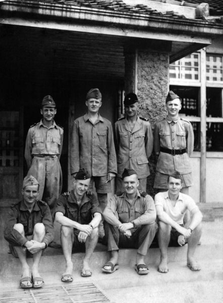 A photo of the POW officers at Keisen, August 1945, with Aidan MacCarthy seated, second from right, taken from 'A Doctor's Sword — How an Irish Doctor Survived War, Captivity and the Atomic Bomb' by Bob Jackson.