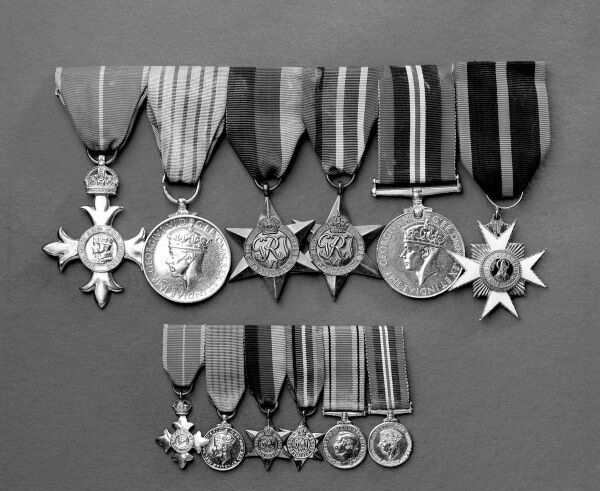 Aidan MacCarthy's medals, from left: OBE, George Medal, 1939-1945 Star, Pacific Star, War Medal 1939-45, and Knight's Cross of the Order of St Sylvester. (The bottom row is the dress version of the medals.) The picture by Barry Murphy is taken from 'A Doctor's Sword —How an Irish Doctor Survived War, Captivity and the Atomic Bomb' by Bob Jackson, published by The Collins Press, 2016.