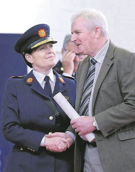 Commissioner Nóirín O'Sullivan with Garda Gerard Flaherty (retired), who received a commendation. Picture: Don Moloney