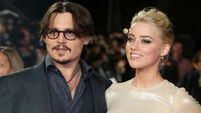 Amber Heard gives divorce cash to charity