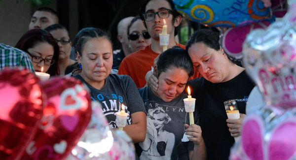 Nicole Maldonado, Myriah Flores, and her mother Sharlene Benavidez attend a candlelight vigil for 10-year-old Victoria Martens. Pic: AP