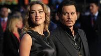 Johnny Depp and Amber Heard settle divorce case