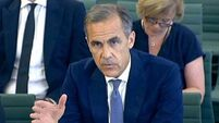 Sterling falls as Bank of England signals more stimulus is possible
