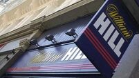 William Hill shares rise as online betting improves