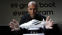 Adidas shares drop as currency swing hits margin