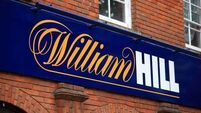 William Hill shares rise as merger talks confirmed