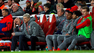 Arsene Wenger: Arsenal 'hanging on' in race