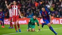 Nine-man Barcelona hang on