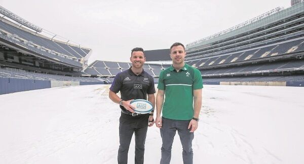 New Zealand's Ryan Crotty and Ireland's Tommy Bowe at Soldier Field