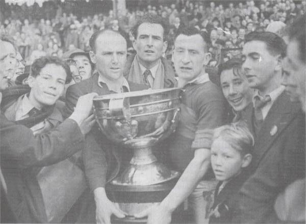 Mayo captain Sean Flanagan with the Sam Maguire and some Mayo supporters after the 1950 All-Ireland final. Picture: The Mayo News