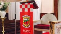 'It has religious meaning.' Priest explains Mayo altar flag that has gone viral