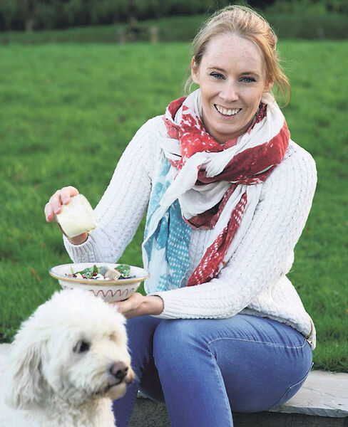 Derval O'Rourke enjoying one of her salads from her second cookery book 'Fit Foodie'. Pictured alongside the former Olympian is her much-loved labradoodle, Berlino.