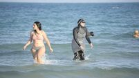 Amid Europe's insecurity, who fears the lady in the burkini?