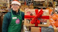 Young adults with Down Syndrome working at Cork's English Market in run up to Christmas