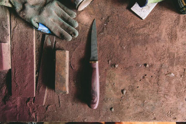 A finished knife amid the debris of Fingal's workshop.