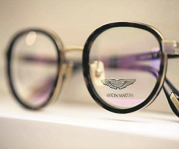 The Aston Martin name sits on the glass of a pair of spectacles
