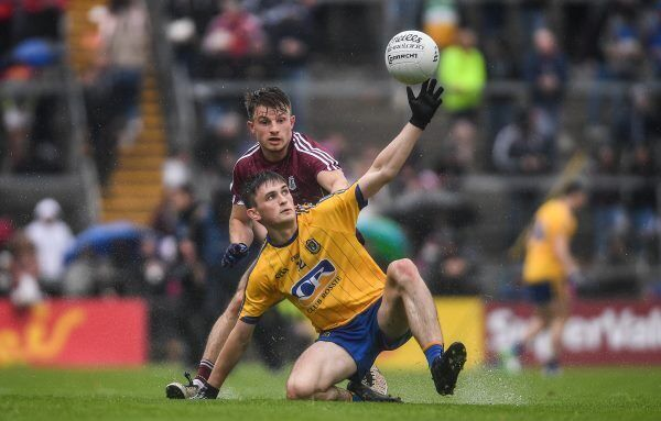Brian Stack of Roscommon in action against Eoghan Kerin of Galway. Photo by Ramsey Cardy/Sportsfile