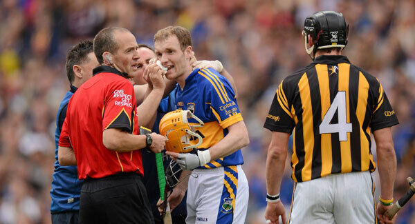 Referee Cathal McAllister speaks to Lar Corbett as tempers fray between the Tipperary forward and Kilkenny defender Jackie Tyrrell in the 2012 All-Ireland semi-final.