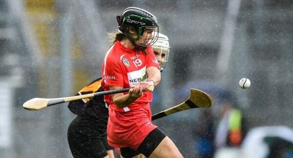 Julia White of Cork scores the winning point in injury time during the All-Ireland Senior Camogie Final. Pic: Matt Browne/Sportsfile