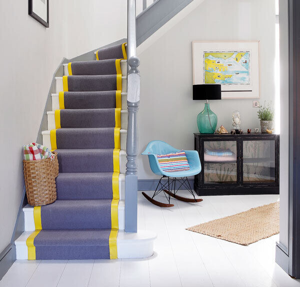 Staircase and hallway in Sandymount by Optimise. The yellow stripe on the stairs carpet lifts a subtle grey composition.