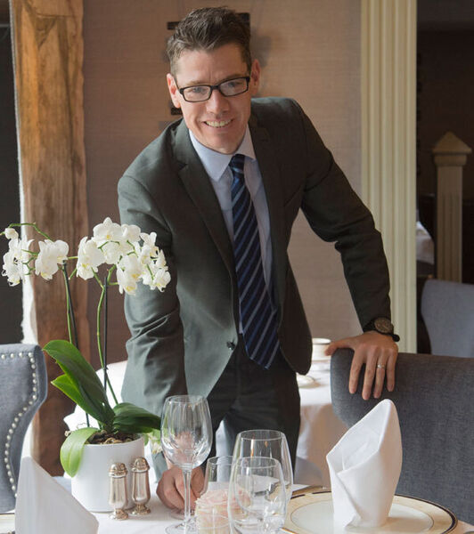 TJ Mulcahy adjusting the table settings at Hayfield Manor, Cork, where he is general manager. The key is not to get stressed out, when entertaining, he says. Picture Dan Linehan