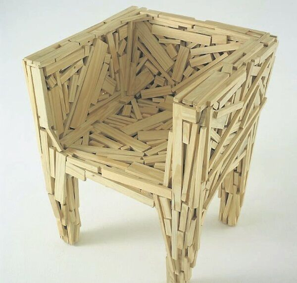 The iconic Favela chair by Estudio Campana is made from pieces of wood randomly connected by glue and nails.