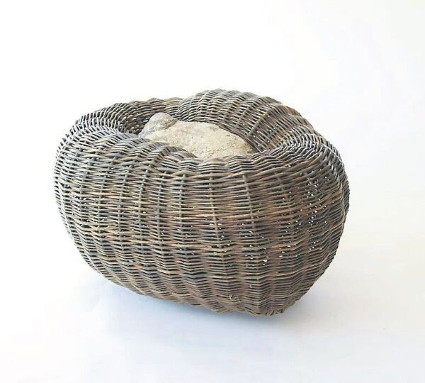 Pod on lichen encrusted beechwood by Irish basket maker Joe Hogan, whose work began with practical objects like potato baskets, and has now evolved to take on a sculptural aesthetic.