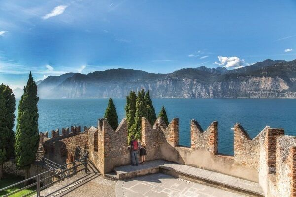 Melcesine is an ancient town filled with lush Mediterranean foliage and olive groves with Lake Garda views.