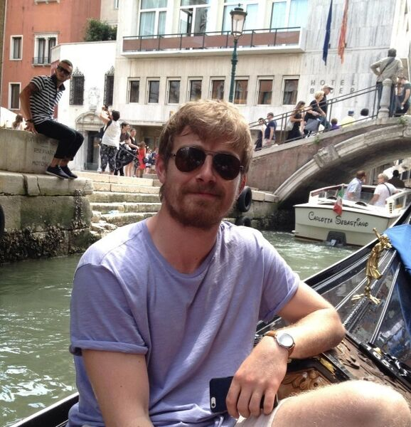Adrian Buckley gliding along the canal at leisure on a gondola in Venice.