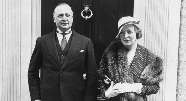 Edmund Maurice Burke Roche, Baron Fermoy (1885 - 1955) and his wife Lady Fermoy after attending a society wedding.