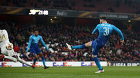 Red-faced Arsenal survive scare