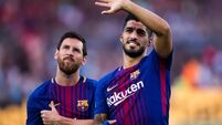 Suarez breaks duck as Barca put one foot in semis