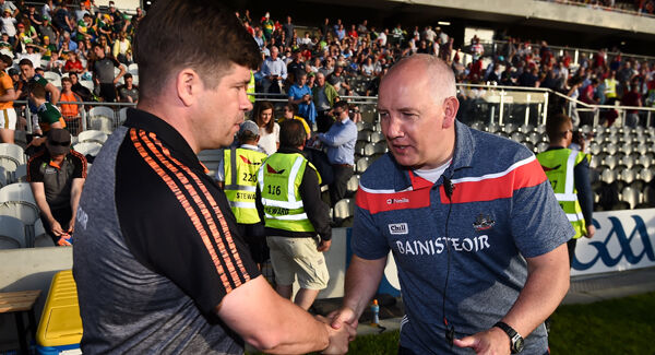 Éamonn Fitzmaurice and Ronan McCarthy shake hands after the Kingdom's 17-point win