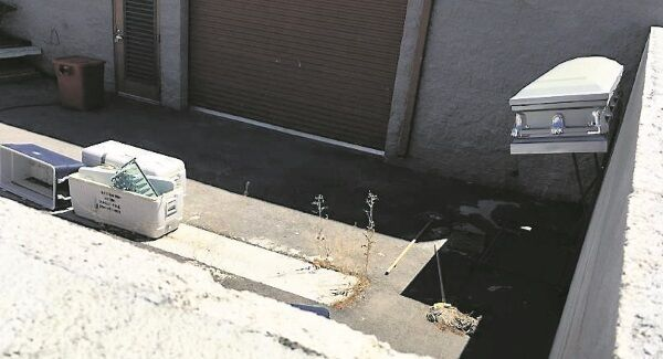 A coffin, mops, and coolers used to transport body parts lie in an abandoned courtyard outside a warehouse once shared by Southern Nevada Donor Services. Picture: Reuters