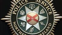 Device thrown at officers in Armagh