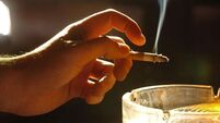 Outdoor areas in bars should be non-smoking during social distancing, doctors say