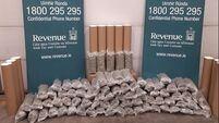 €800k of cannabis and thousands in sterling seized in two separate searches