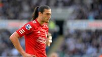 Uncertain future for Carroll as Reds reject Magpies deal