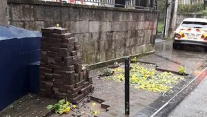 Vandals dig up Cork streets, neatly stack paving slabs and fill holes with flowers