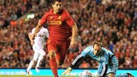 Suarez fires Reds into League group stage