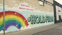 New video shows #HoldFirm mural go from blank wall to art piece