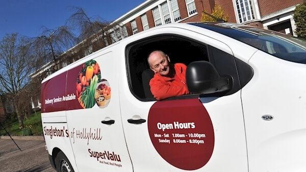 Driver Ian Casey, of Singleton's SuperValu of Hollyhill, makes a food order drop at the North Monastery Primary School in Cork.